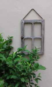 décoration murale extérieure cage oiseau et fenêtre
